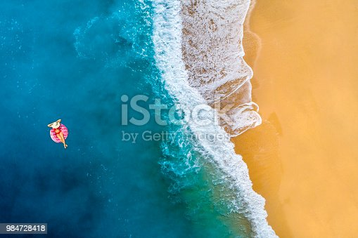 Aerial view of swimming in clear turquoise water. Mediterranean sea.