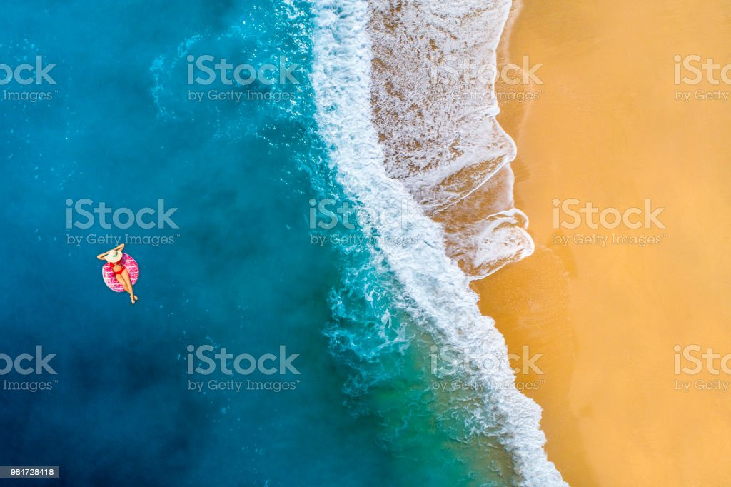 Swimming in clear turquoise sea stock photo