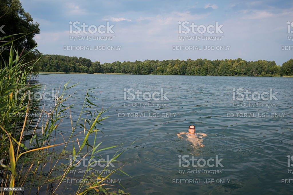 Swimming in Lake Luka in Trakai, Lithuania stock photo