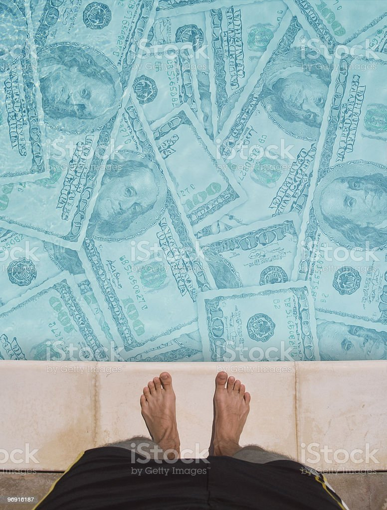 swimming in money royalty-free stock photo