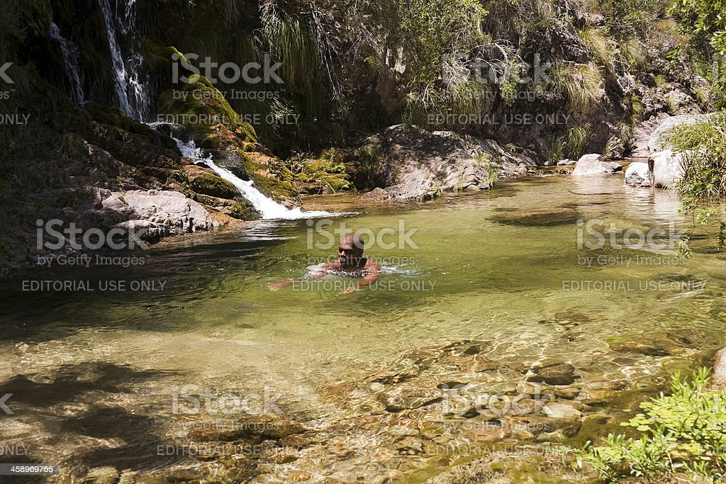 Swimming in the waterfall royalty-free stock photo
