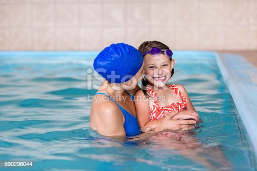 Swimming Instructor Laughing And Smiling With A Young Girl-foton och fler bilder på 4-5 år