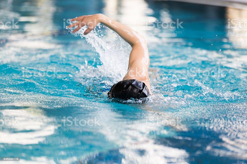 swimming man in swimming pool stock photo