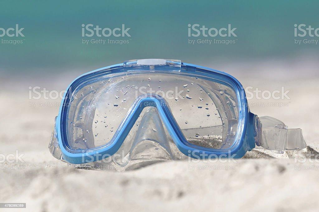 Swimming mask on white sand royalty-free stock photo