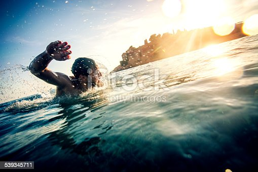 Young man swimming near St. Stefan, Montenegro