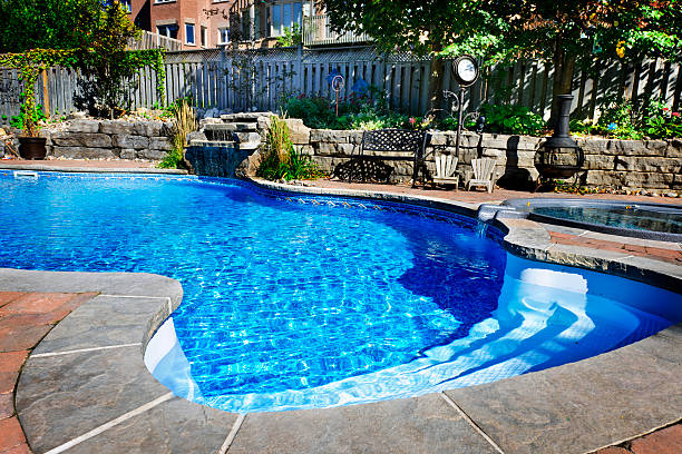 Swimming pool accented with a waterfall stock photo