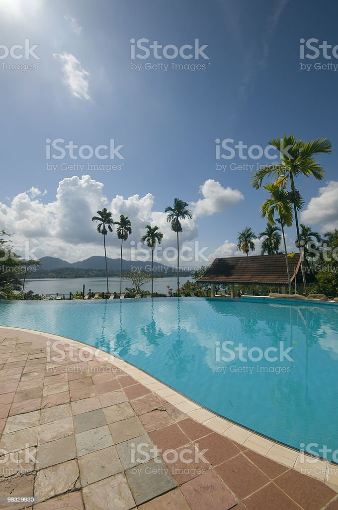 Swimming pool and a man made lake in the background royalty-free stock photo