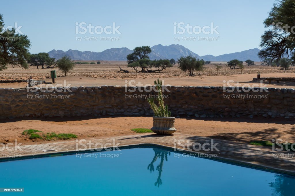 Swimming Pool And Desert Landscape With Mountains Sossusvlei