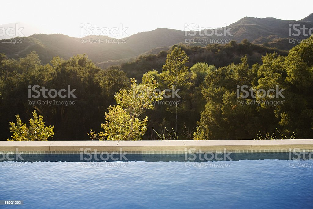 Swimming pool and distant hills royalty-free stock photo