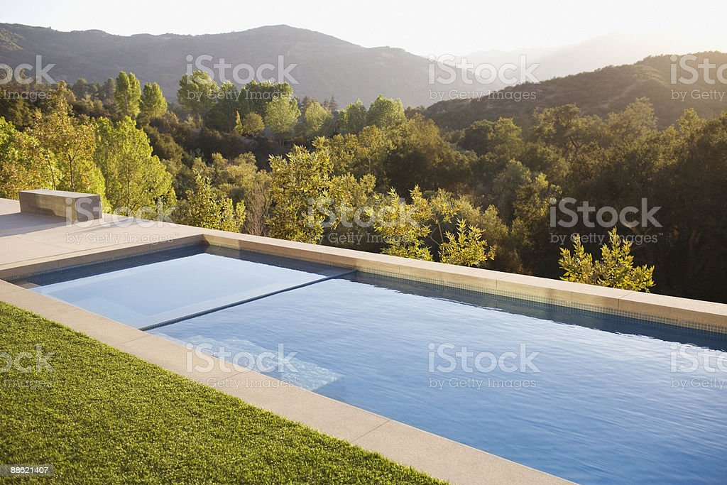 Swimming pool and distant hills stock photo