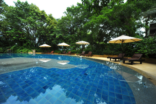 Swimming Pool At A Tropical Resort Stock Photo - Download Image Now