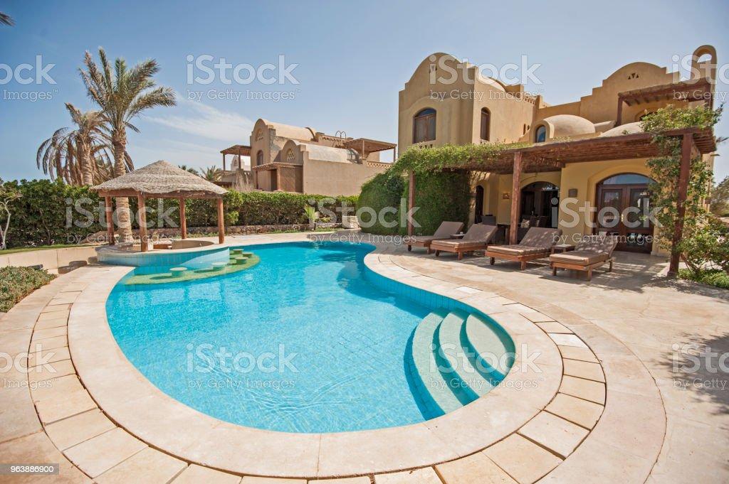 Swimming pool at at luxury tropical holiday villa resort royalty-free stock photo