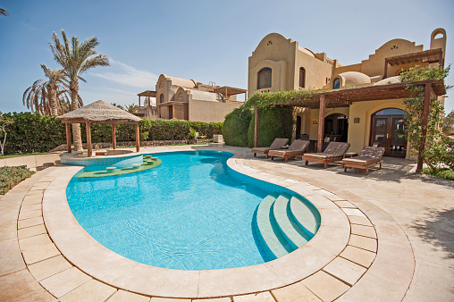 Swimming Pool At At Luxury Tropical Holiday Villa Resort Stock Photo - Download Image Now