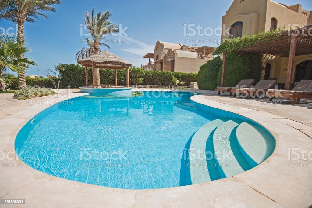Swimming pool at at luxury tropical holiday villa resort - Royalty-free Architecture Stock Photo