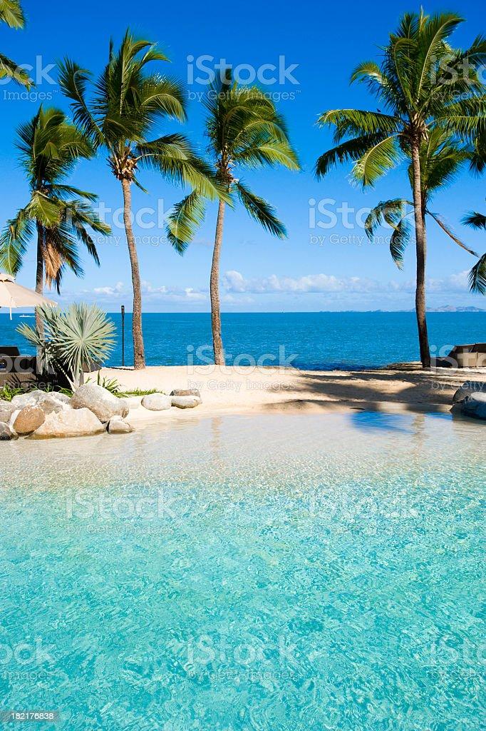 Swimming pool at beach resort stock photo
