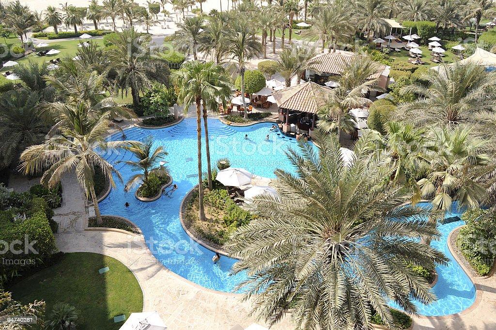 Swimming pool at hotel recreation area, Dubai, UAE royalty-free stock photo