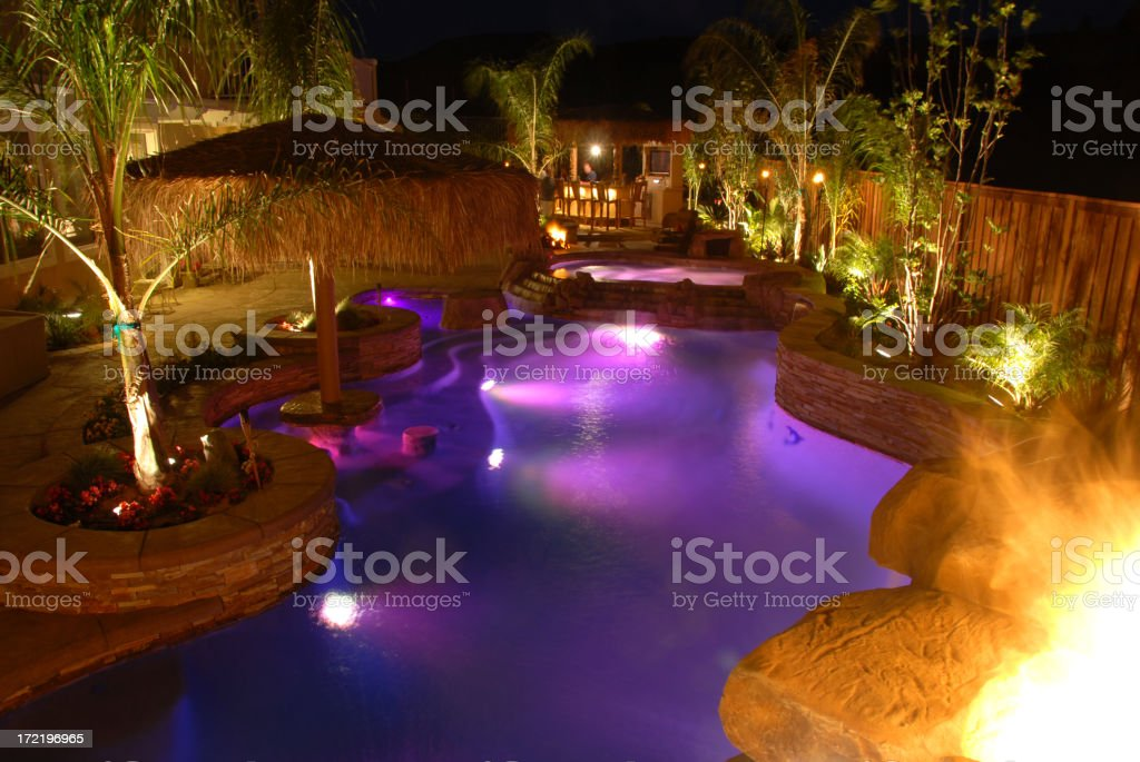 Swimming pool at night lite up purple  royalty-free stock photo