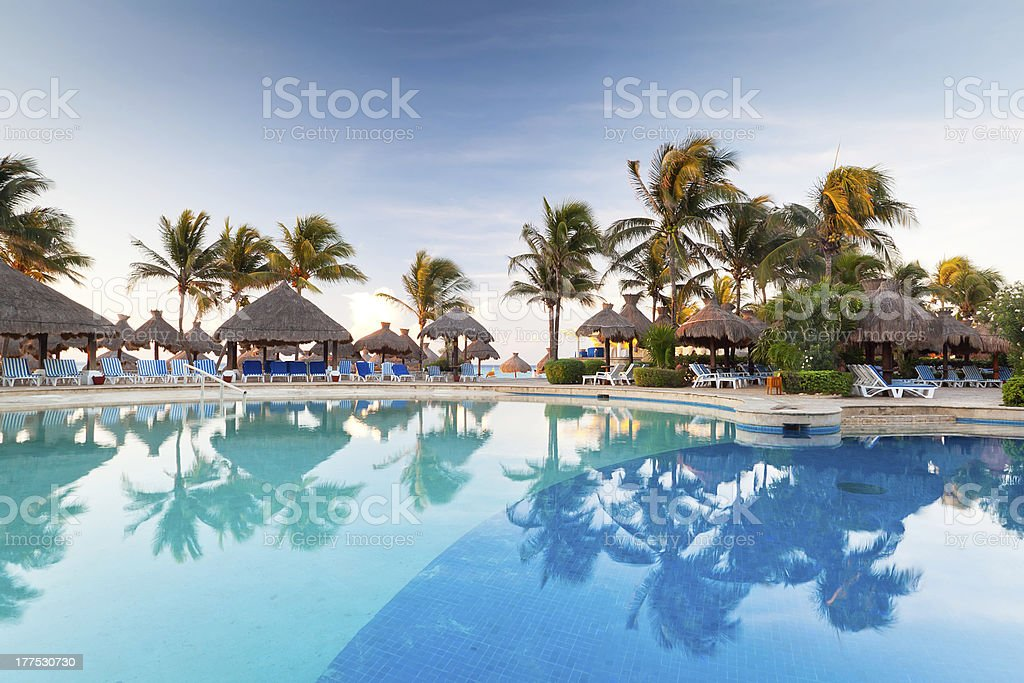 Swimming pool at sunrise in Mexico stock photo
