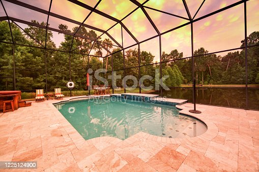 A Swimming Pool at Sunset with a Lake View