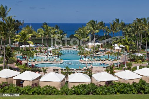 Kapalua Maui, Hawaii, USA - February, 7th 2010: People enjoying the swimming pool at the Ritz Carlton in Maui.