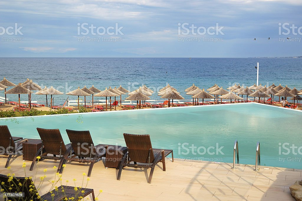 Swimming pool by a beach, Halkidiki, Greece royalty-free stock photo
