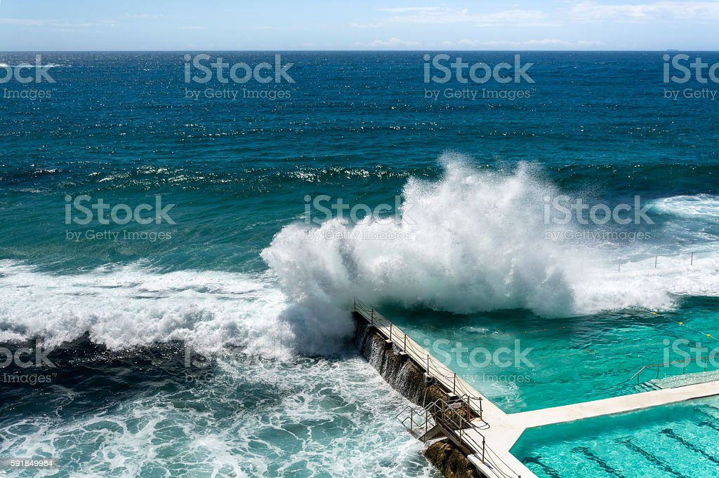 Swimming pool by the sea stock photo