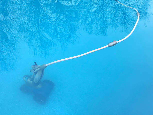 Swimming Pool Cleaner cleaning the swimming pool suction tube stock pictures, royalty-free photos & images