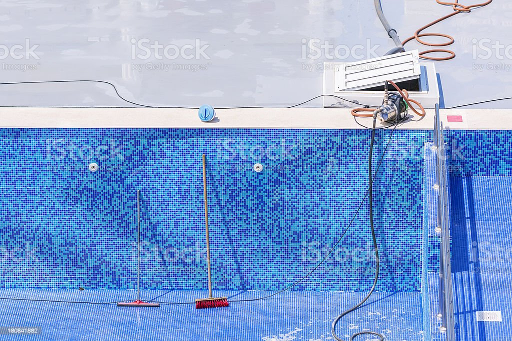Swimming pool cleaning and repairs royalty-free stock photo