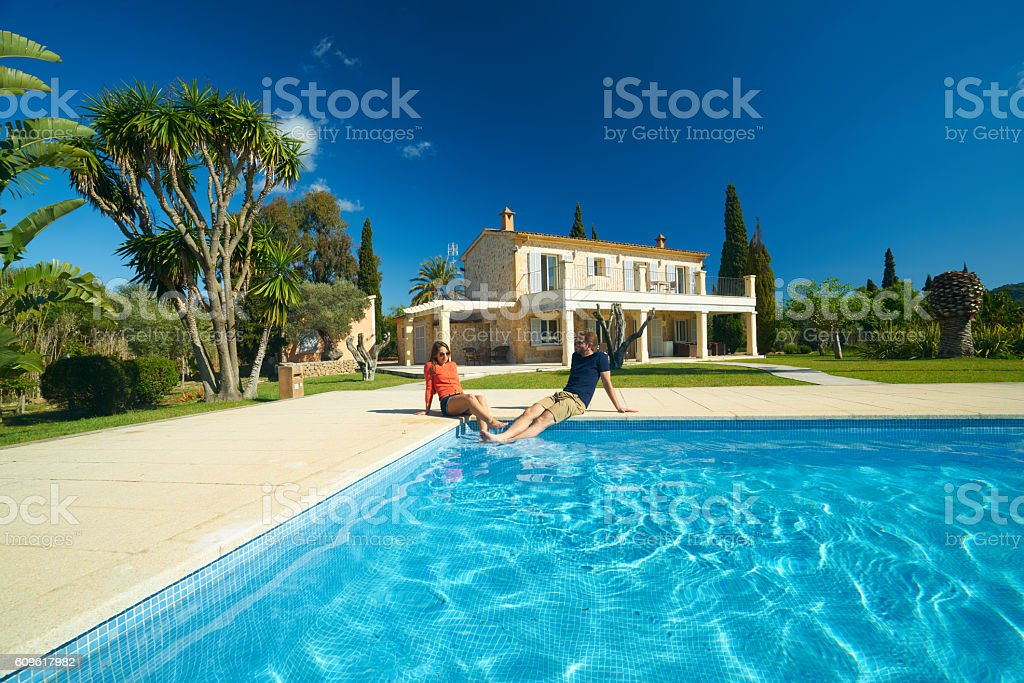 swimming pool, couple and finca house stock photo