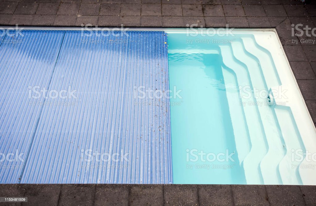 Swimming pool cover detail for protection and heat the water, pool...
