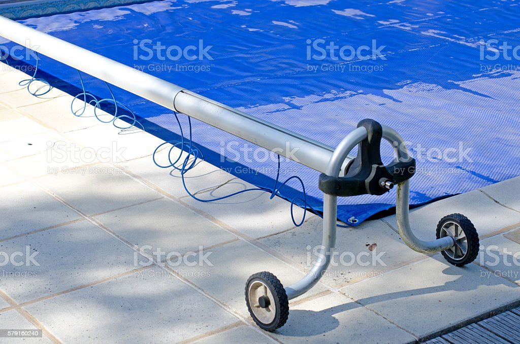 Swimming pool cover off its roller – Foto