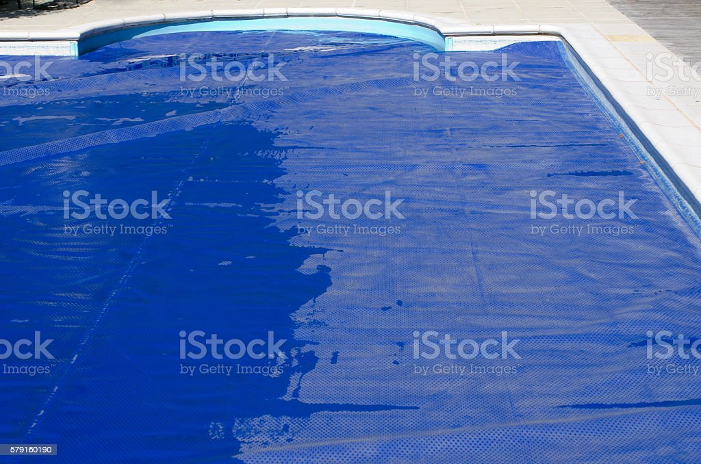 Swimming pool cover on a domestic swimming pool stock photo