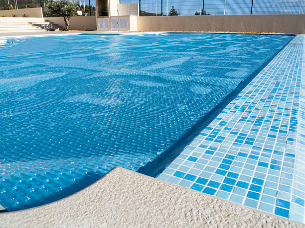 swimming pool cover - covering stock photos and pictures