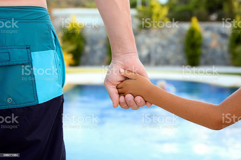 Swimming Pool Father Holds The Hand Of A Small Child Stock ...
