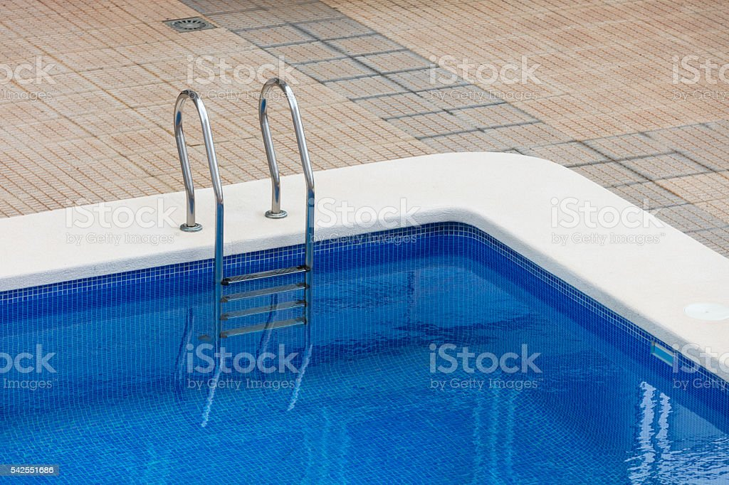 Swimming pool full of turquoise water stock photo