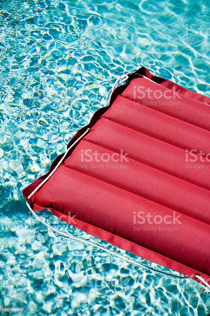 Swimming pool fun with lilo in the sun royalty-free stock photo