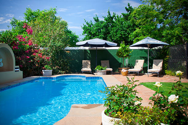 Swimming pool garden Swimming pool garden backyard pool stock pictures, royalty-free photos & images