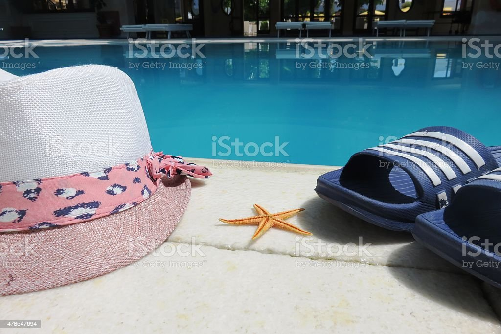 Swimming pool Holiday shoes sarong shells stock photo