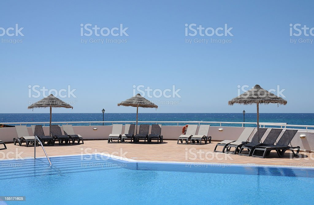 Swimming pool in a tropical resort royalty-free stock photo