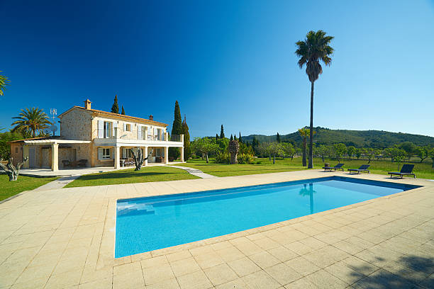 swimming pool in cultivated garden and private finca house stock photo