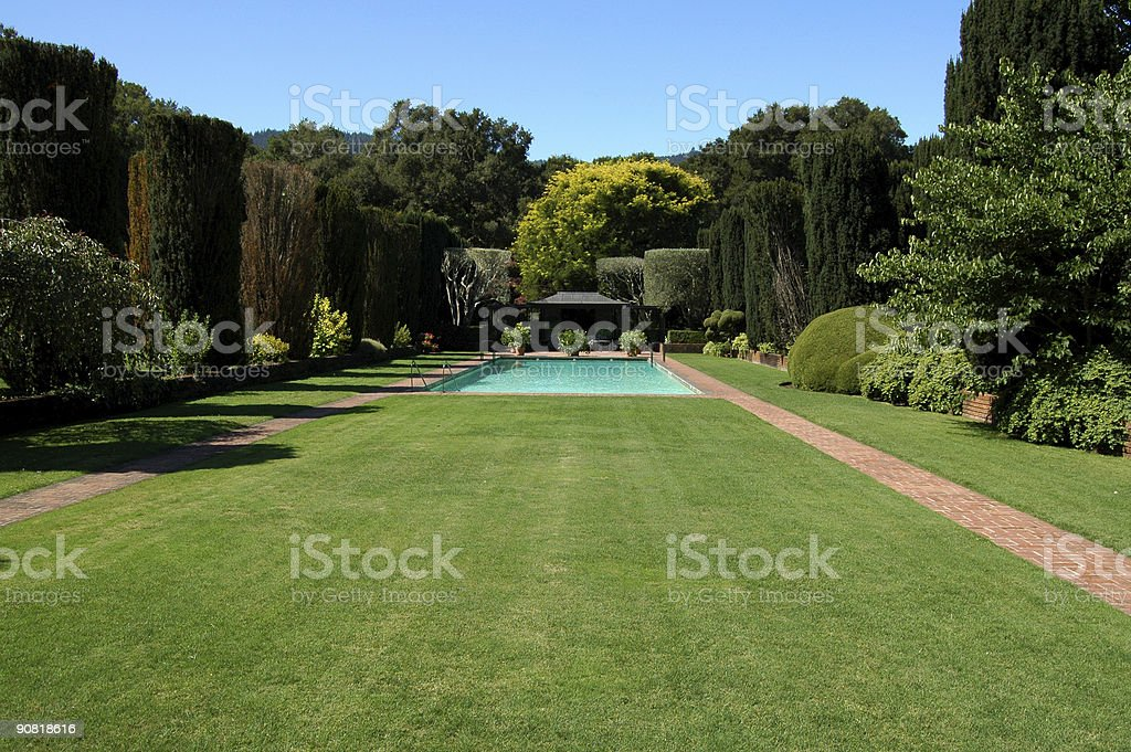 swimming pool in formal garden royalty-free stock photo