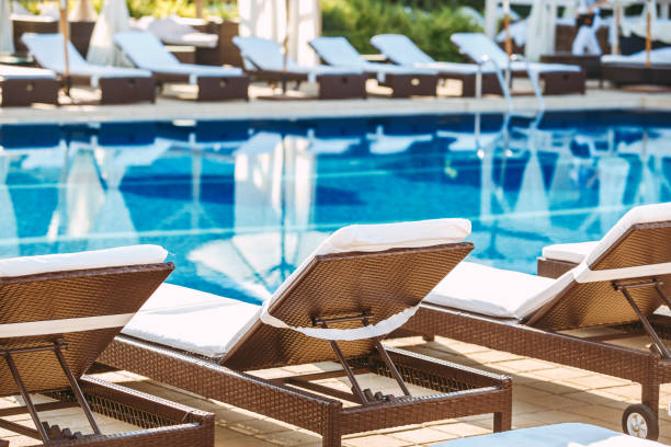 Swimming pool leisure rest loungers no people stock photo