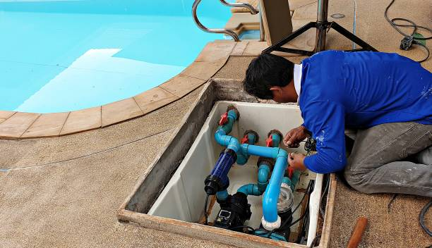 Swimming pool maintenance Technician fixing swimming pool water pump. Service and maintenance for swimming pool. swimming pool stock pictures, royalty-free photos & images