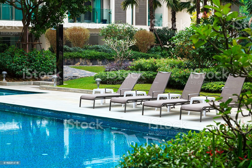 Swimming pool mit apartment houses in the background stock photo