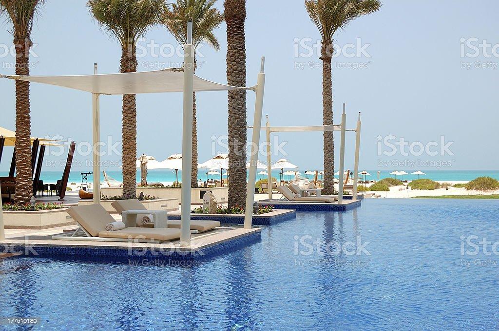 Swimming pool near beach at the luxury hotel, Saadiyat island stock photo