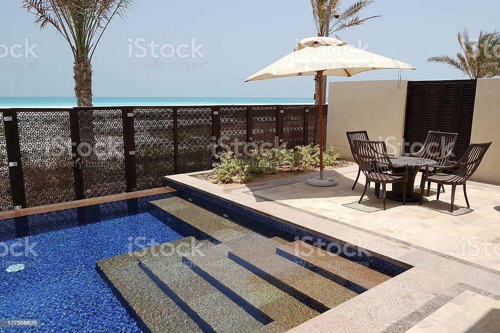 Swimming pool near beach of the luxury hotel stock photo