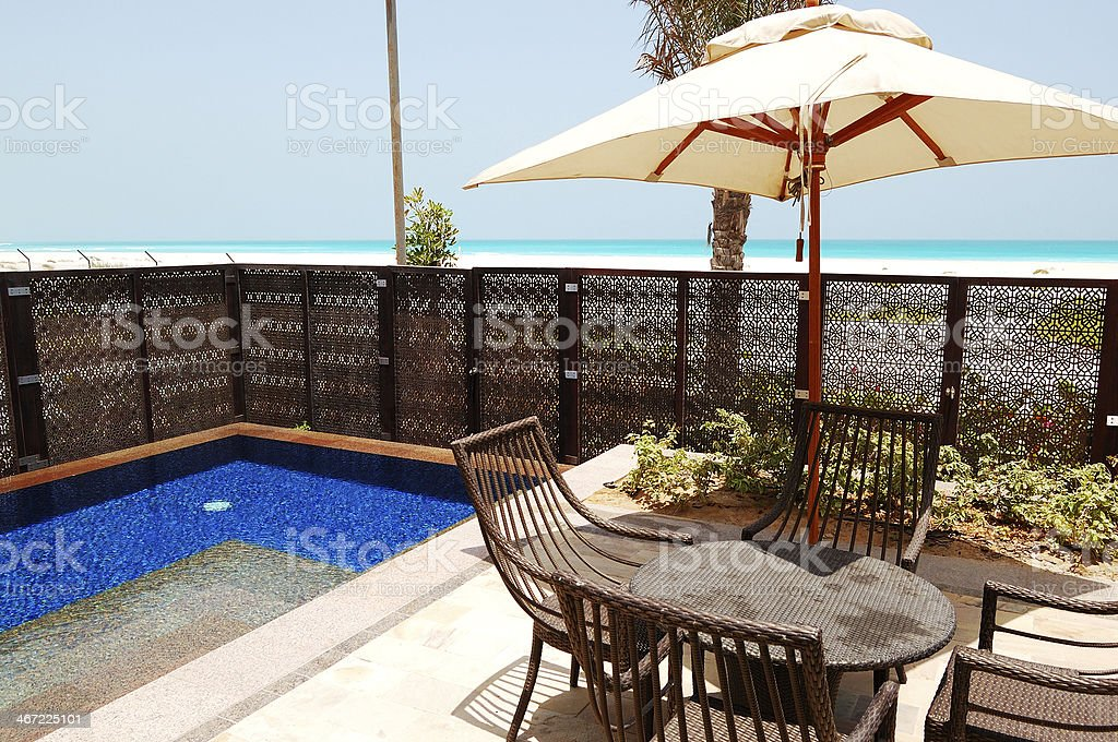 Swimming pool near beach of the luxury hotel, Saadiyat island stock photo