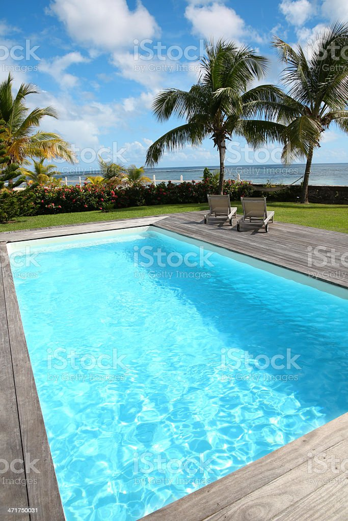 Swimming pool near tropical beach royalty-free stock photo