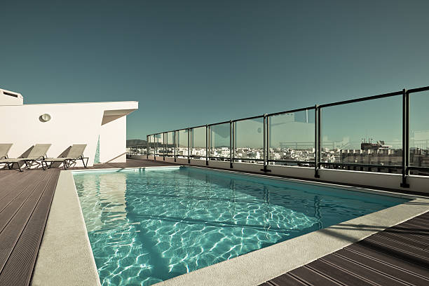 A swimming pool on the top of a house on a sunny day stock photo