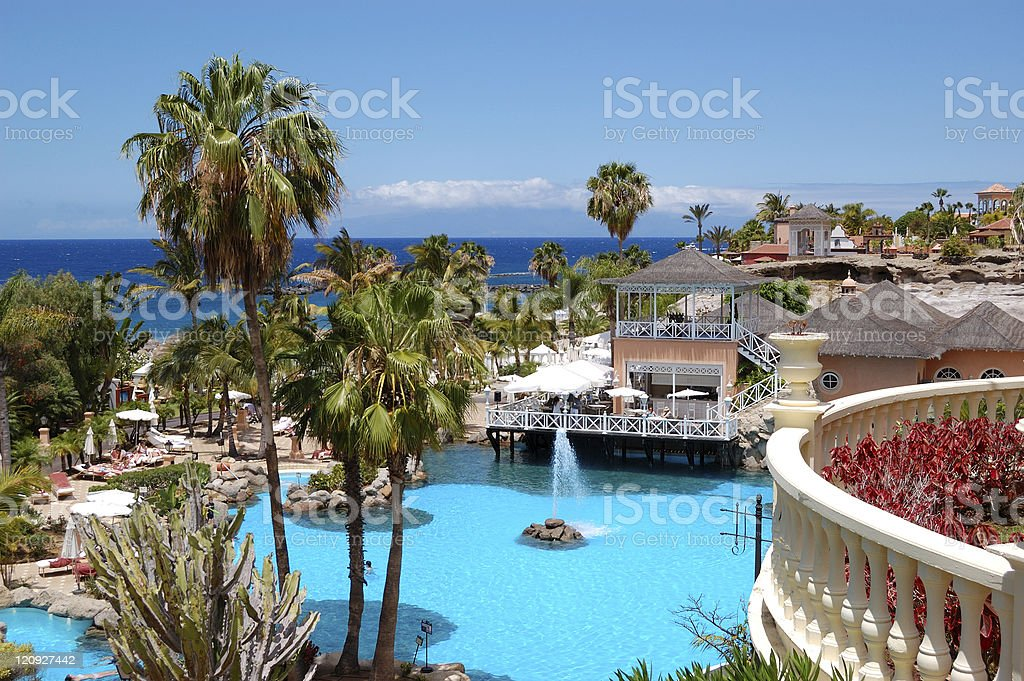 Swimming pool, open-air restaurant and beach of luxury hotel royalty-free stock photo